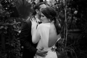 Bride and groom in a botanical garden