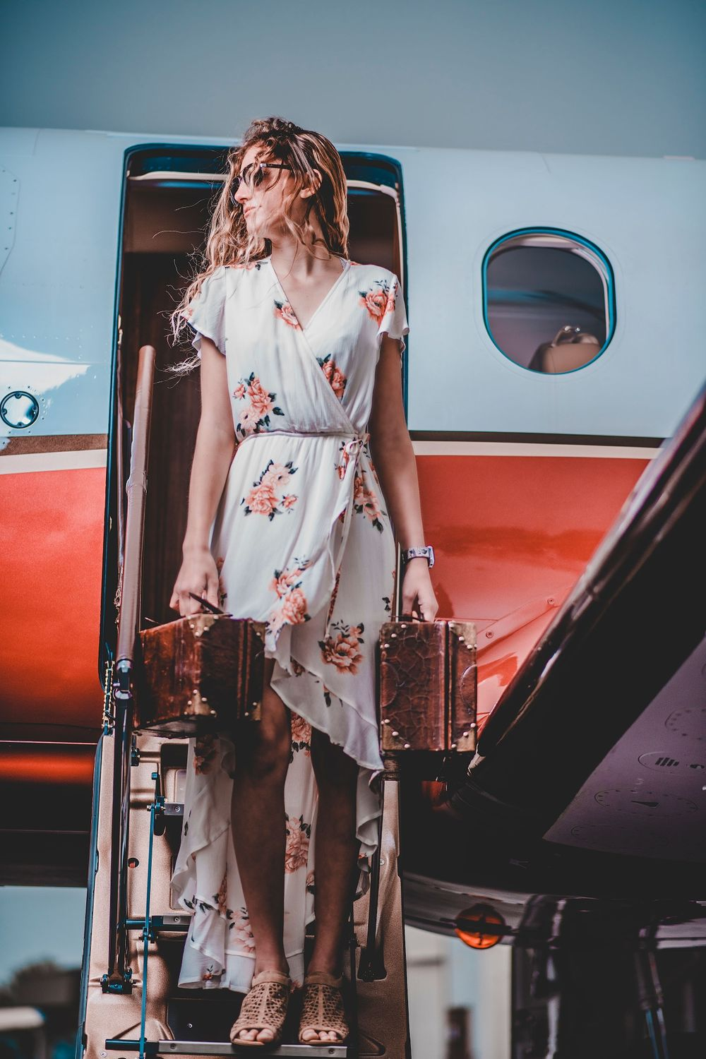 Fashion Portrait of girl in dress for senior photos with airplane