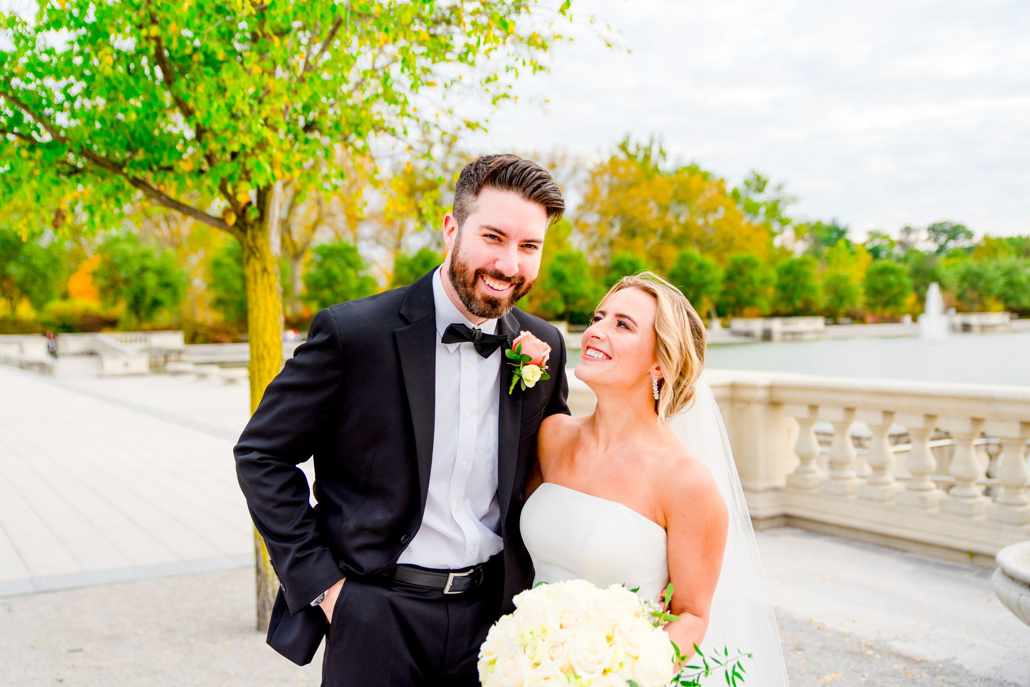 blonde bride smiling at brunette groom for fall wedding pictures in Forest Park STL
