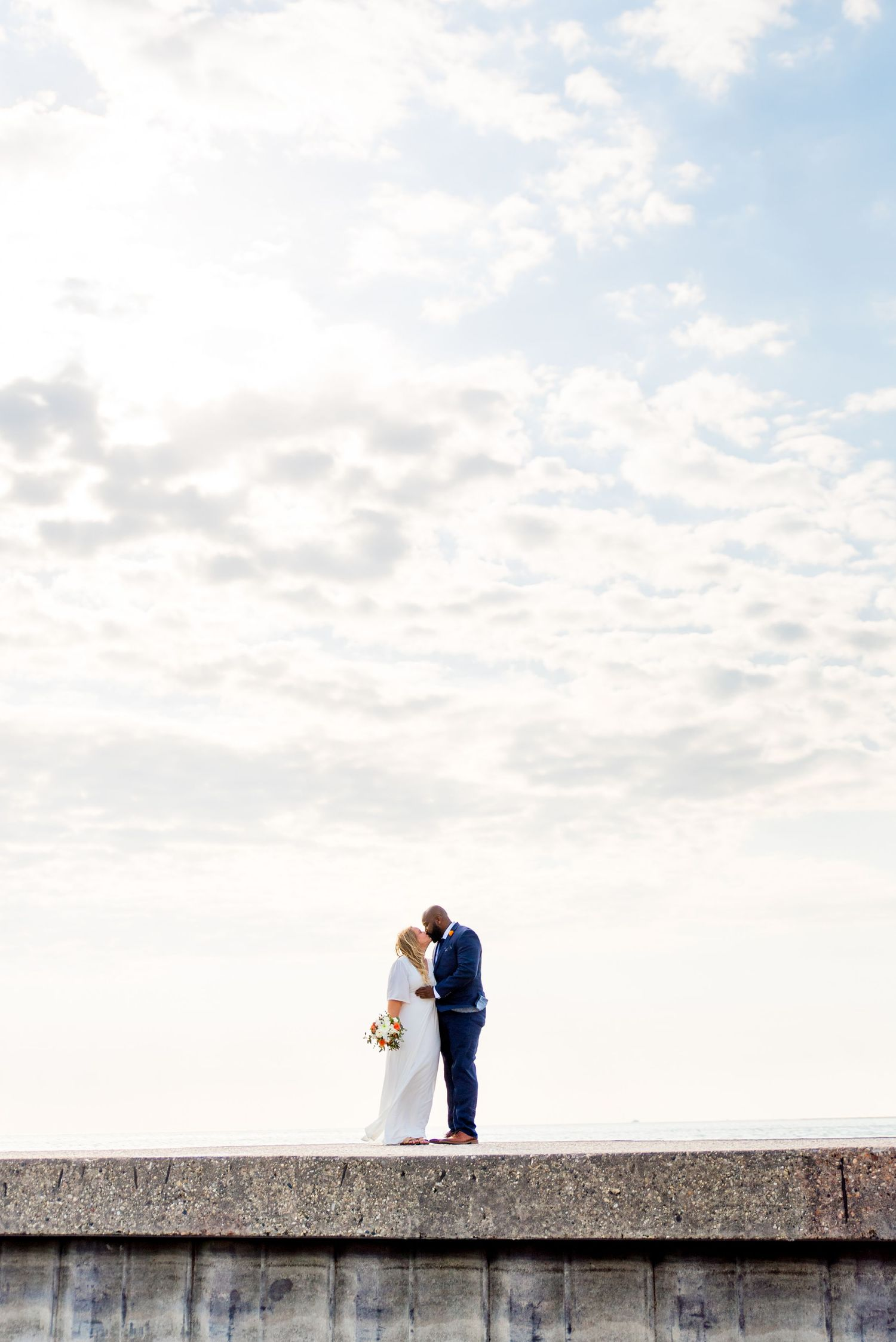 man and woman standing on pier for north avenue beach chicago wedding photos