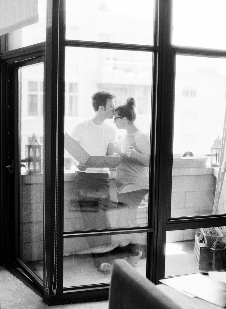 Washington D.C. wedding engagement photographer Aaron Snow Photography engaged couple home kiss black and white