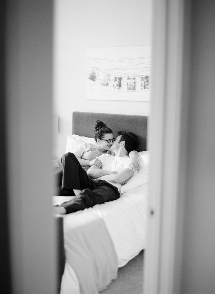 Washington D.C. wedding engagement photographer Aaron Snow Photography engaged couple home in bed black and white