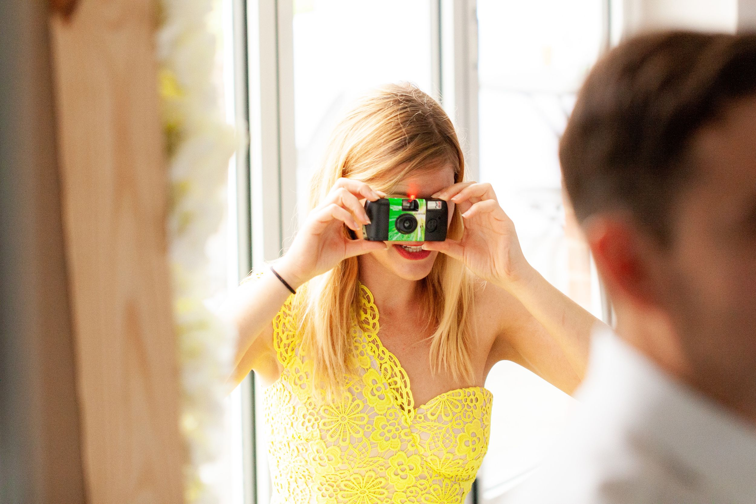 Wedding guest takes o photograph with a disposable camera - Wedding Photography