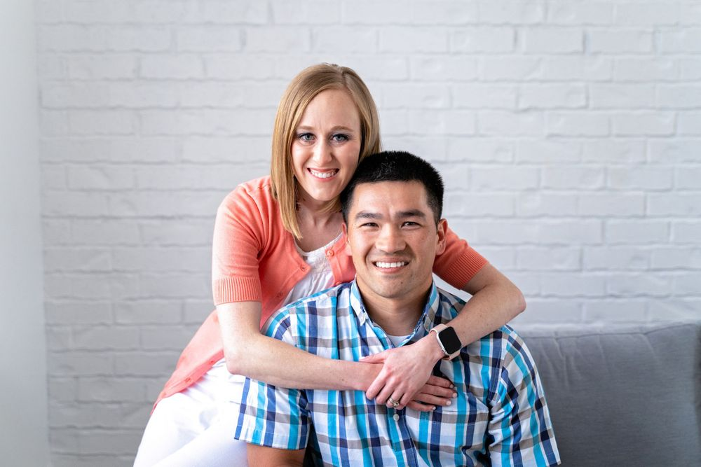 woman with arms around man smiling