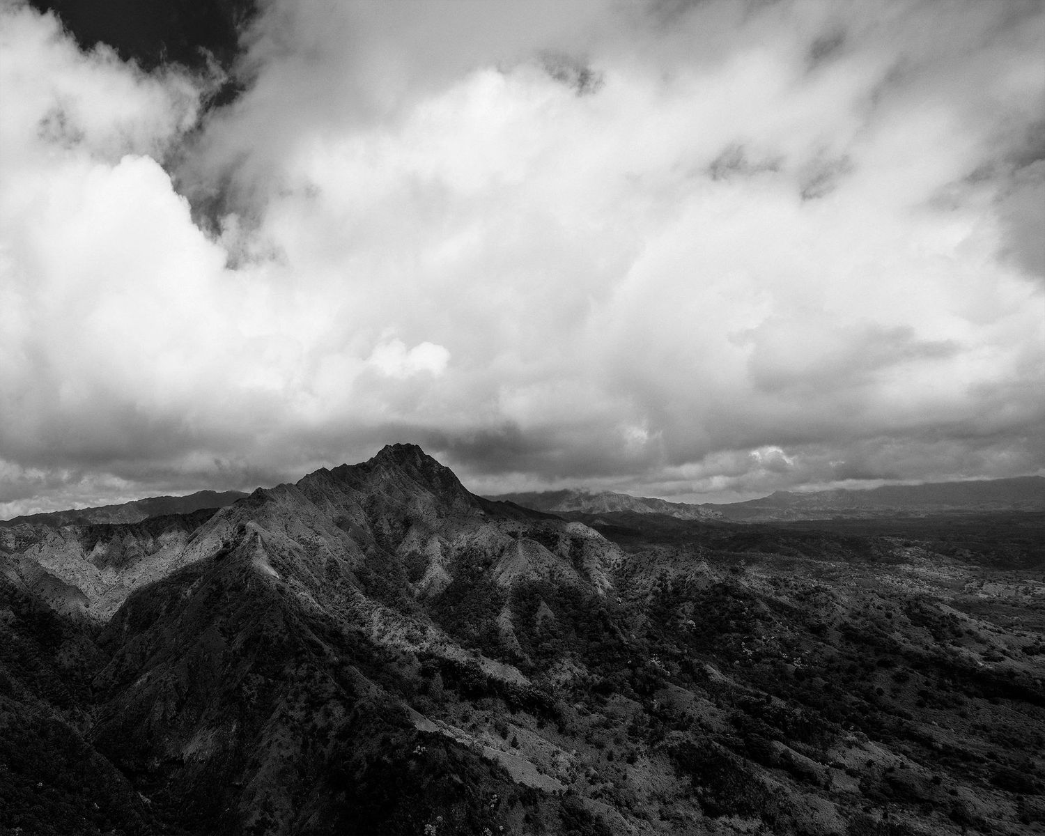Black and white image of Hawaiian Mountain with clouds