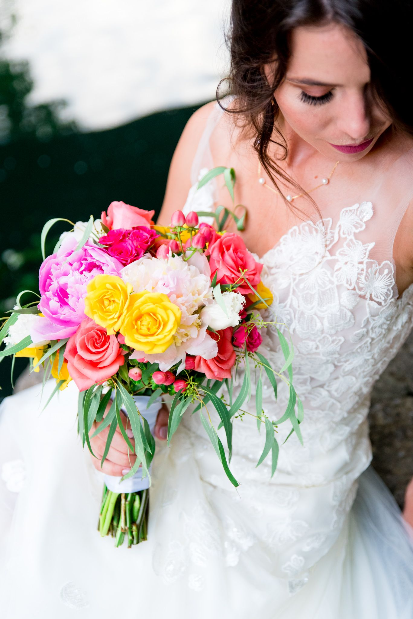 brown hair bride holding yellow and pink bouquet, wearing Serafina Gown by Kelly Faetanini