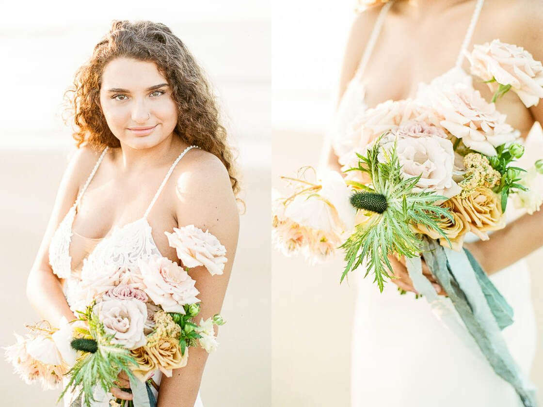 bride showing off her bouquet for a flowy boho styled shoot with ivory & beau on tybee island