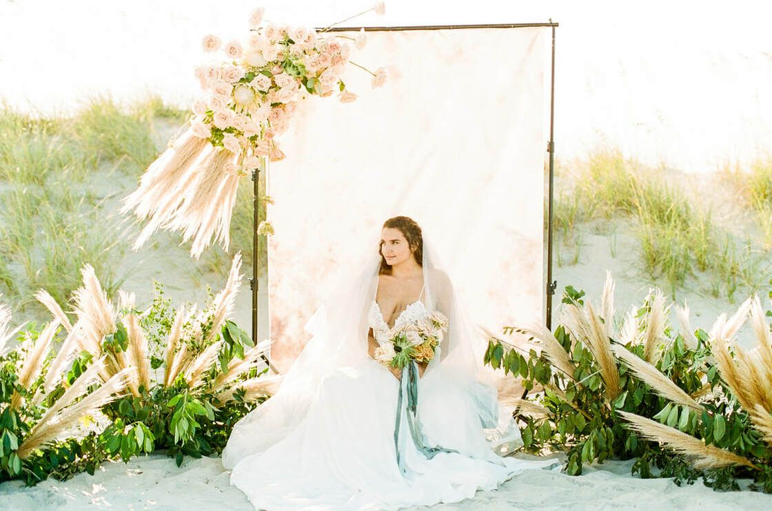 gorgeous bridal portrait with blooms for boho styled shoot with ivory & beau on tybee island,