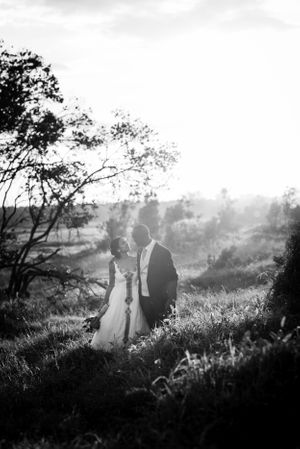 A couple in B&W with beautiful light behind them