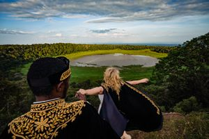 Safari wedding couple at the edge of a crater