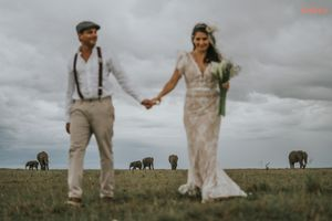 Bride and groom with elephants in Masai Mara