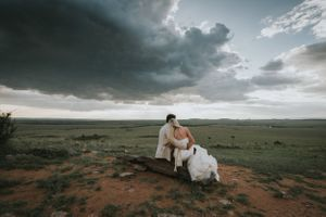 Newly married couple admiring the scenery in Masai Mara