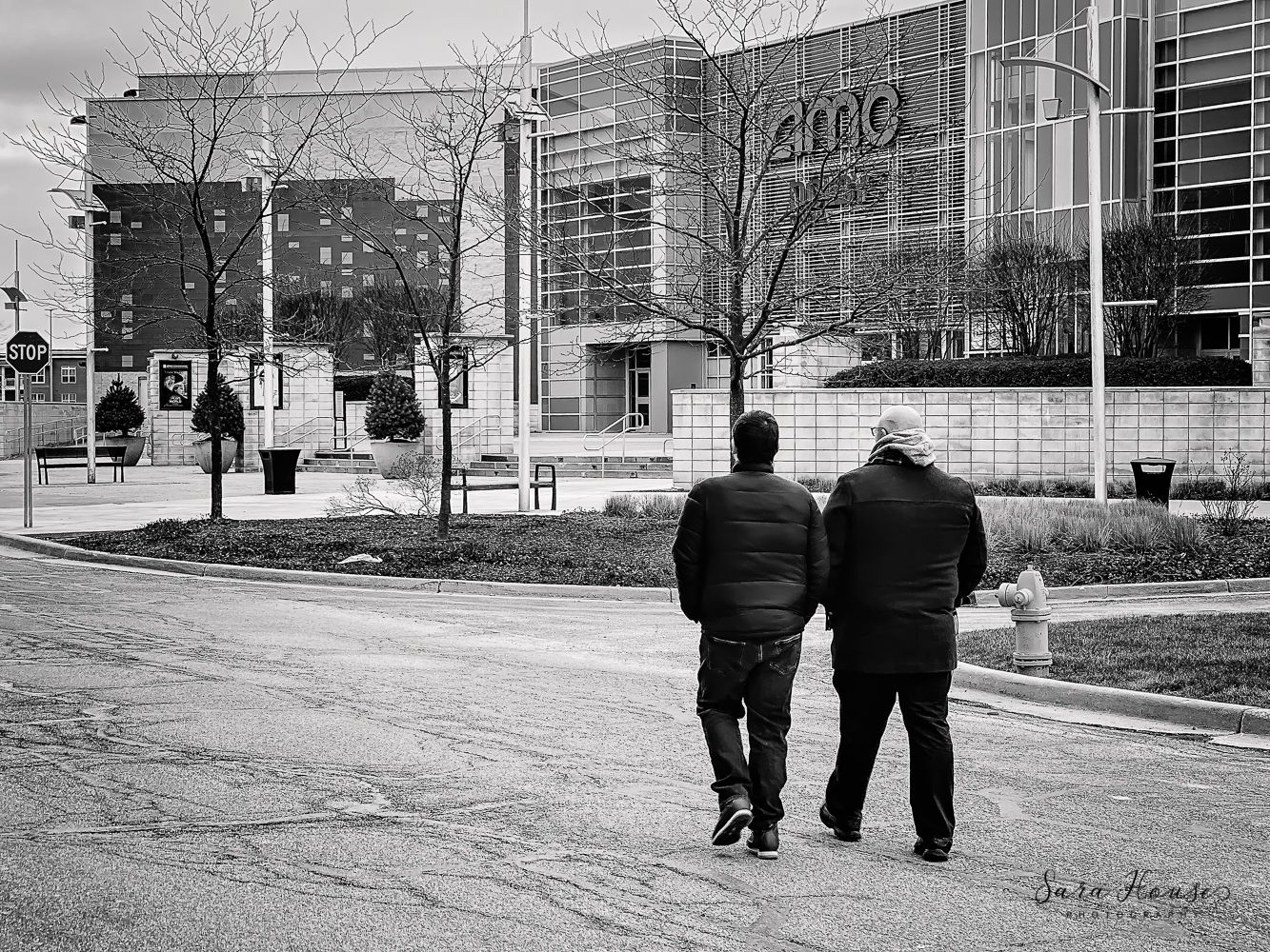 Two guys walking by movie theater at the shops at Perry crossing in plainfield Indiana
