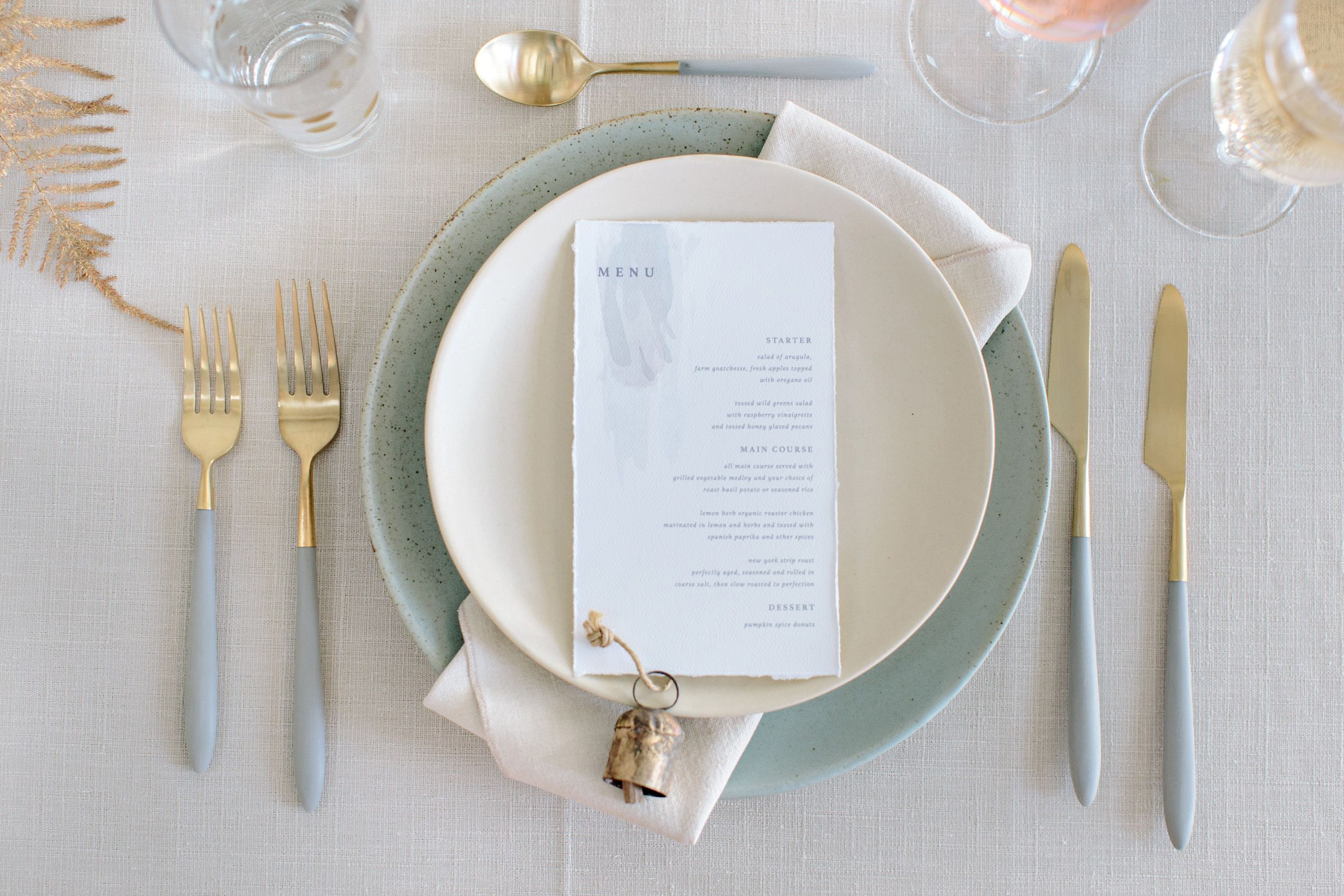 table setting with soft speckled robins egg blue linen