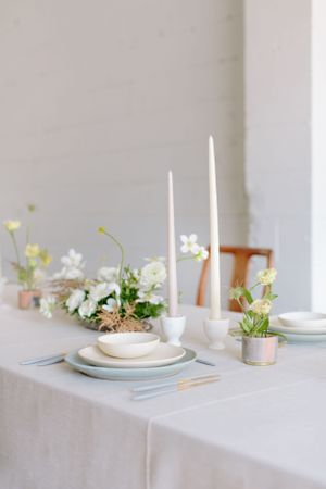 table with accents of gold, soft speckled robins egg blue