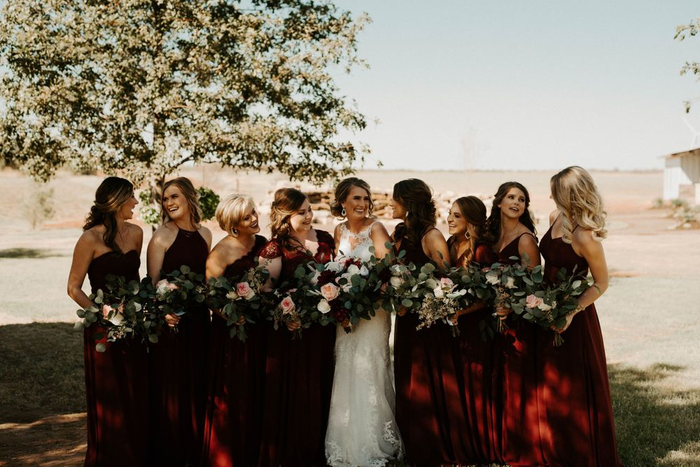 Bride with her bridesmaids in fall wedding at The Reserve at Ranger Creek Ranch wedding venue in Seymour, Texas