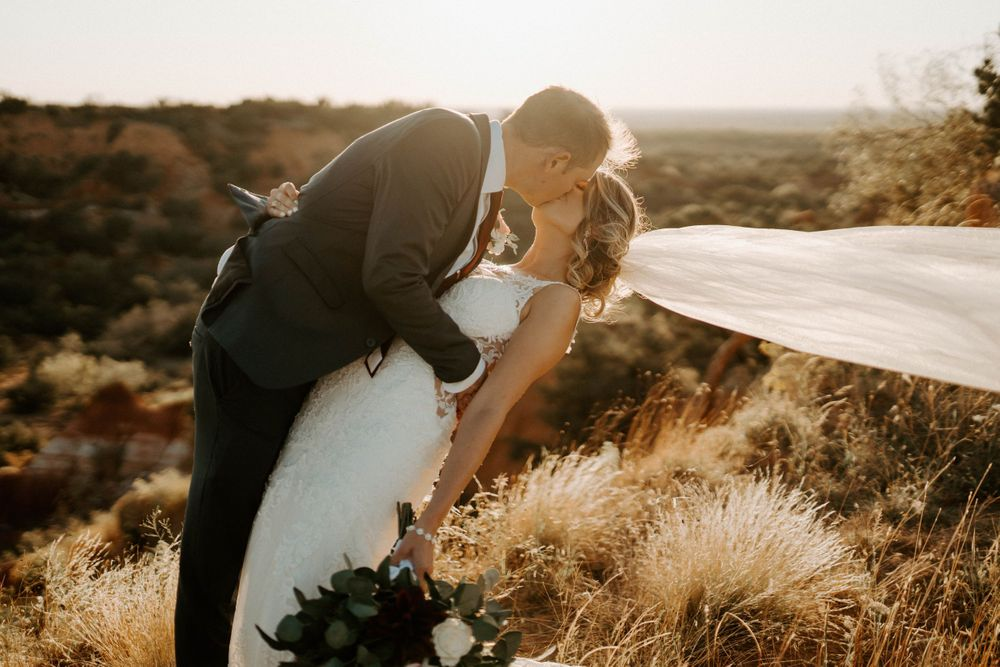 Bride and groom romantic pose outside canyon near Wichita Falls, Texas