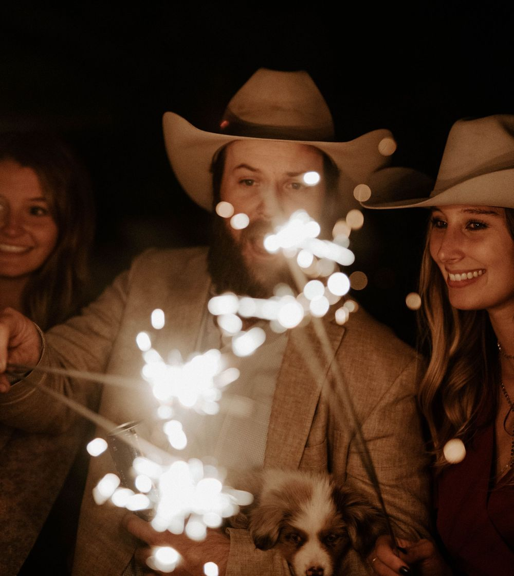 Cowboy hat couple light a sparkler for bride and groom exit at The Reserve at Ranger Creek Ranch in Seymour, Texas