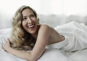 White sheet session of smiling blonde woman