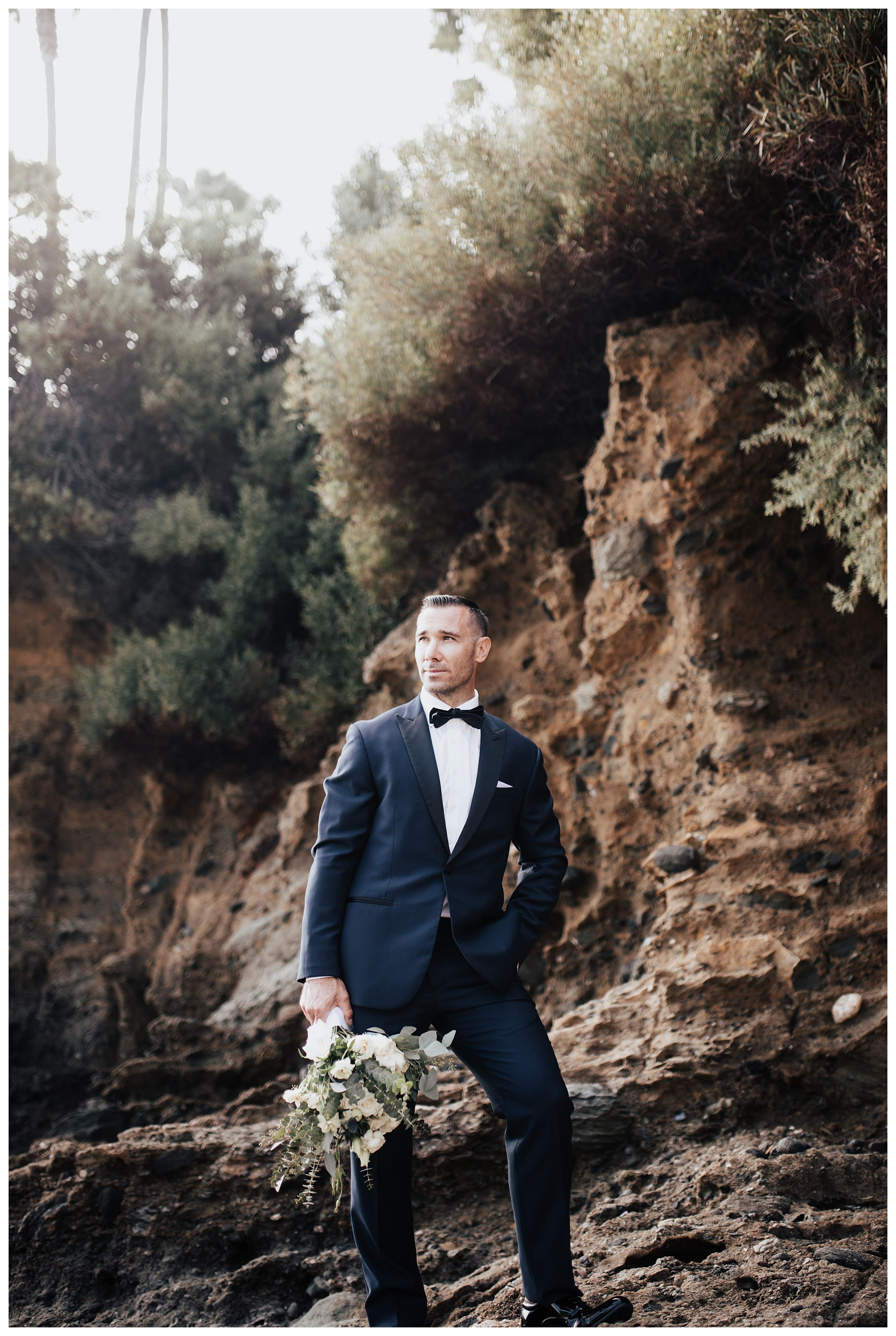 groom on beach, groom holding bouquet, groom wedding photos