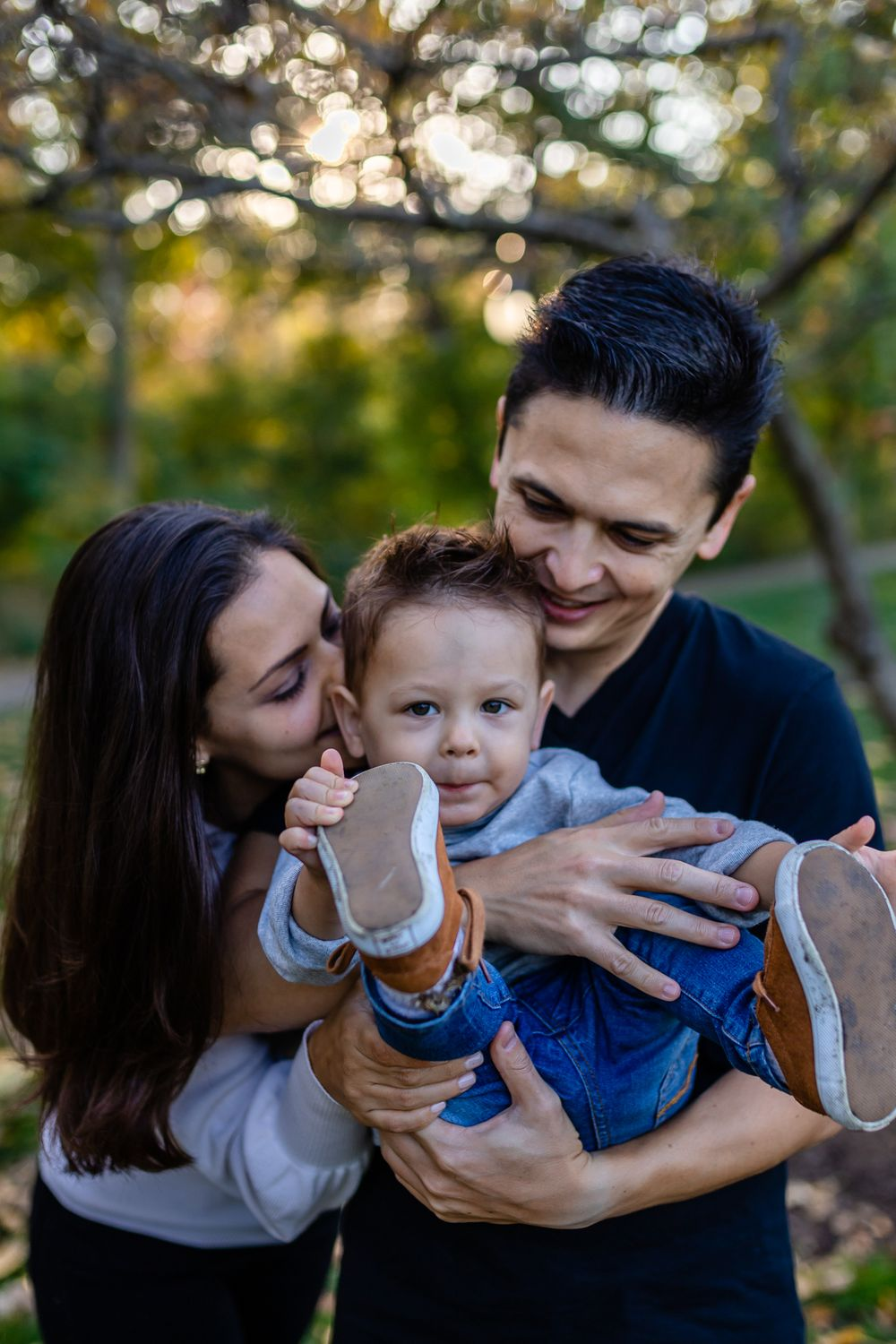 parents holding toddler boy closer Chicago family lifestyle session