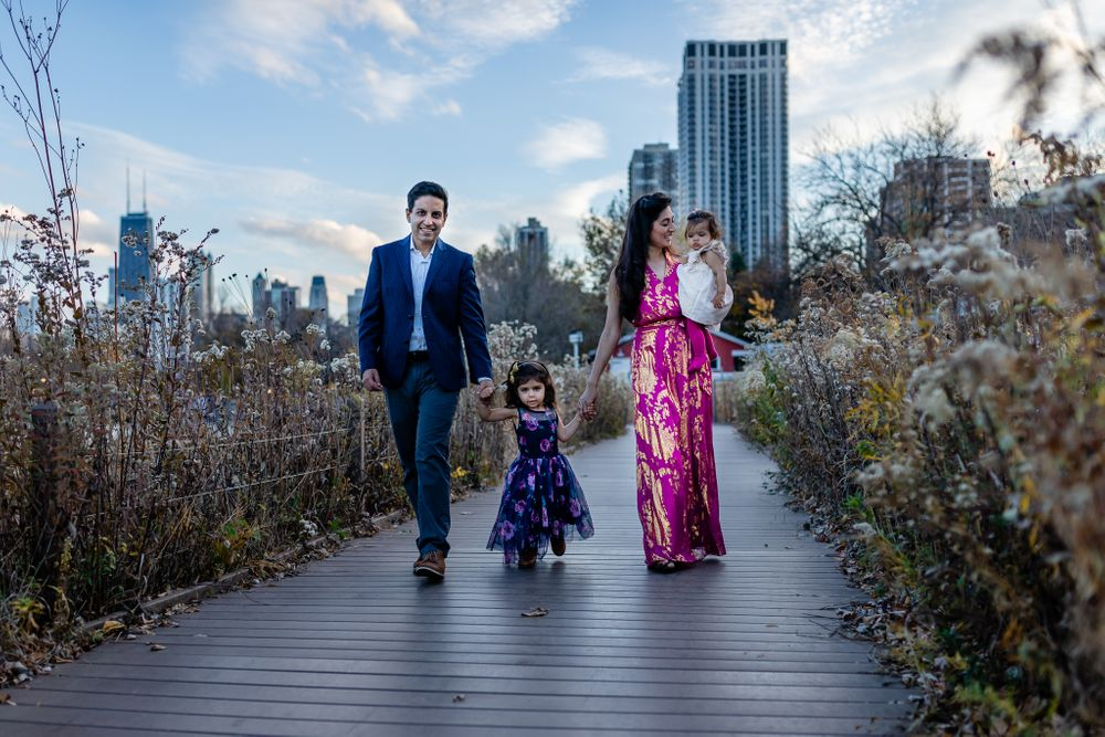 family of four walking in the nature riverwalk Chicago family lifestyle session