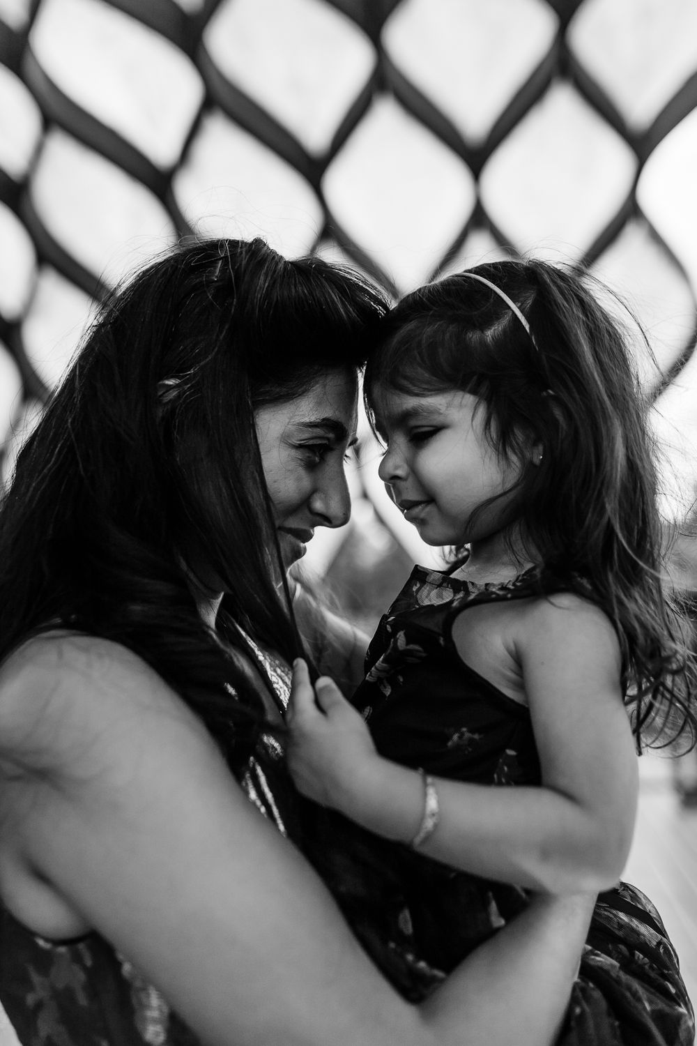 mother and daughter touching foreheads under honeycomb Chicago family lifestyle session