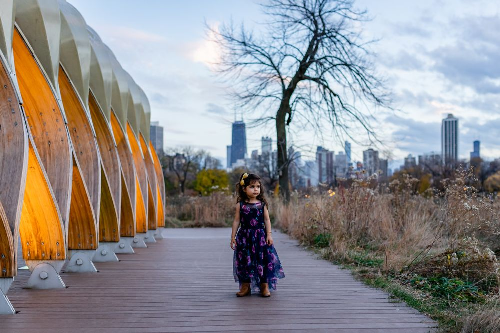 toddler girl waling by honeycomb installation Chicago family lifestyle session