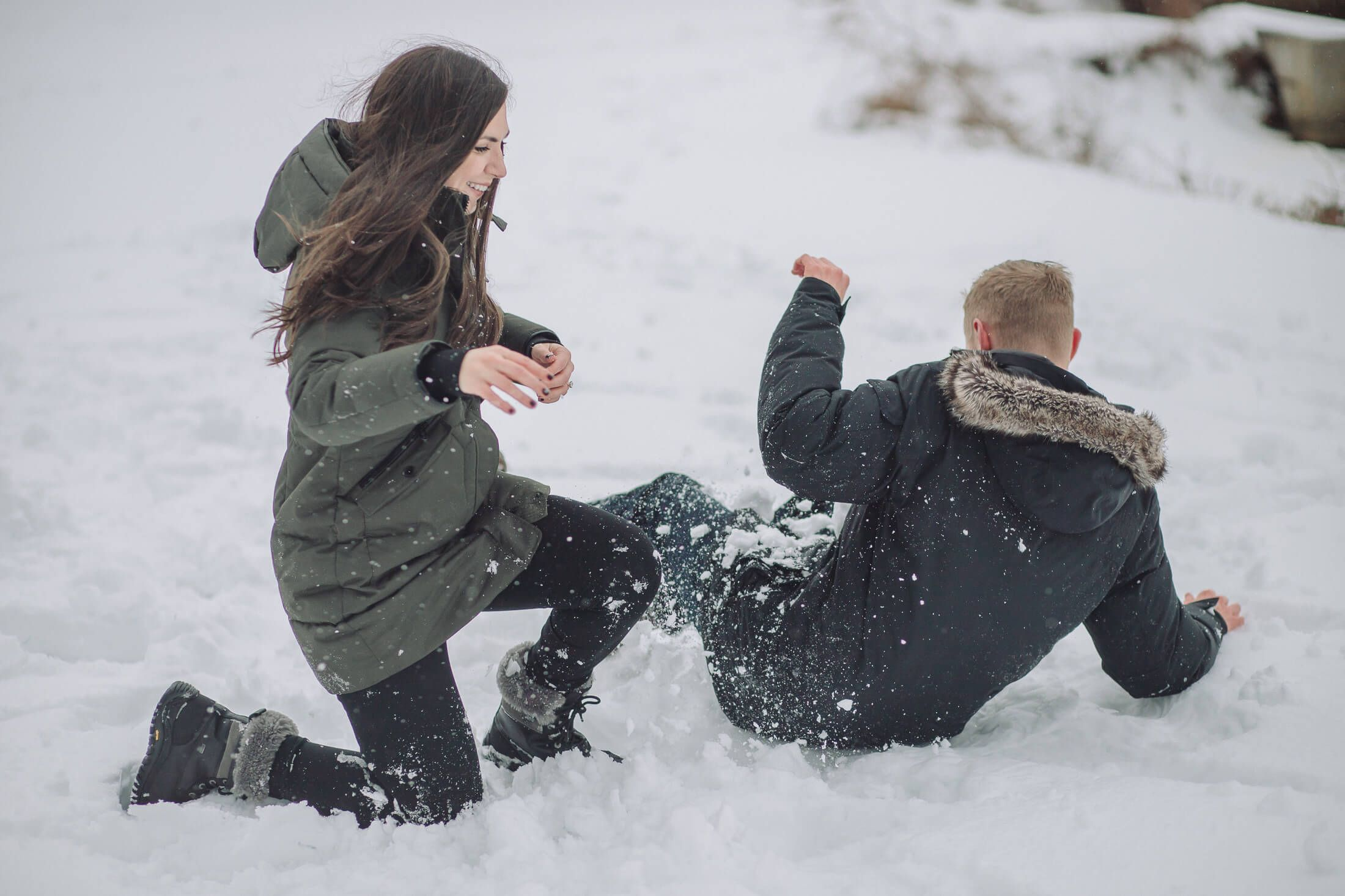 Snow ball fight winter engagement session at Cooper River Park in Cherry Hill, NJ.