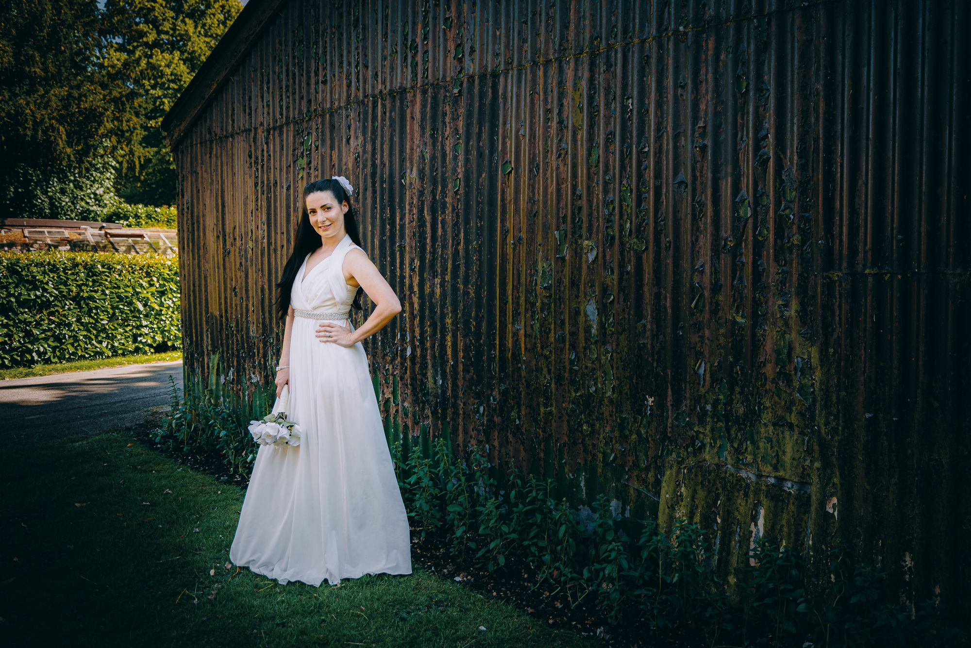 Bride against an iron shed