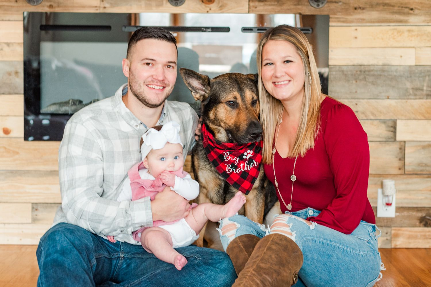 Lifestyle family photoshoot in the home with mom, dad, dog, and 6 month old baby wearing bow in Gibsonia, Pennsylvania