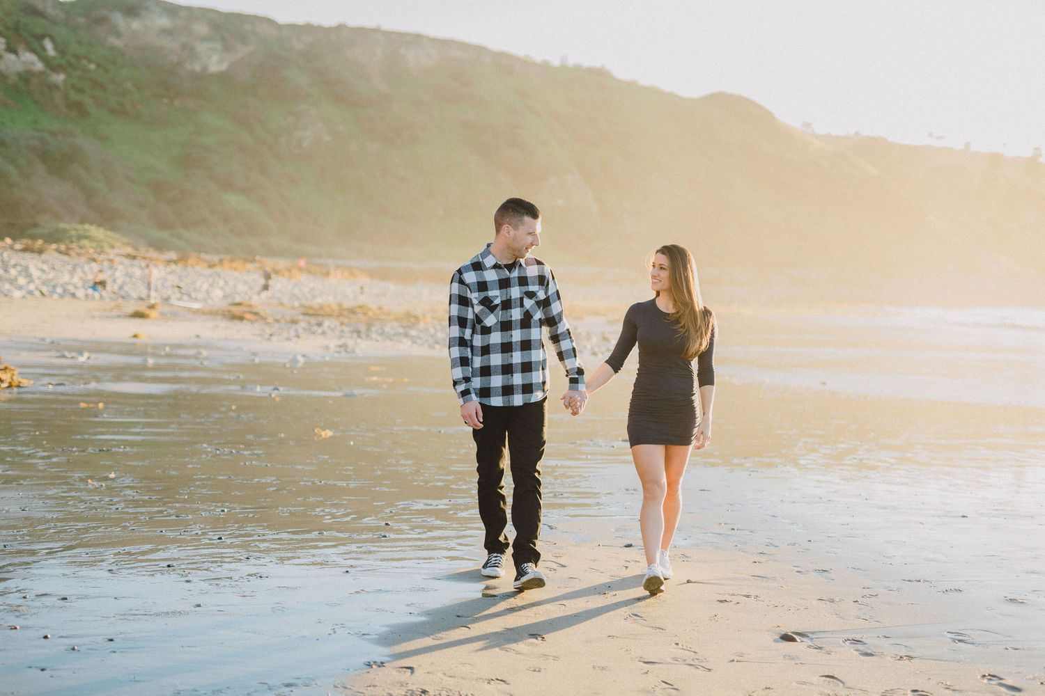 engaged couple walking on the beach in palos verdes