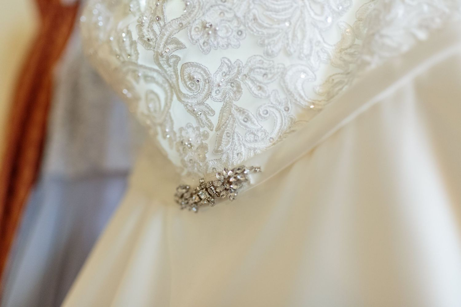 close up of the lace and detail on the wedding dress