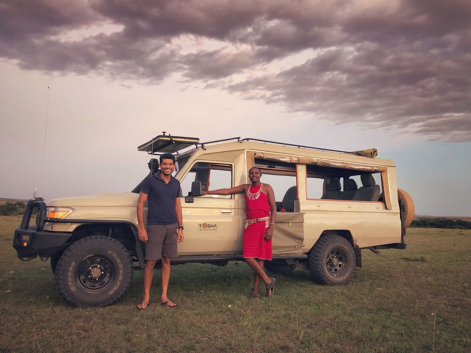 our safari car with the Drivers and Guides in Masai Mara