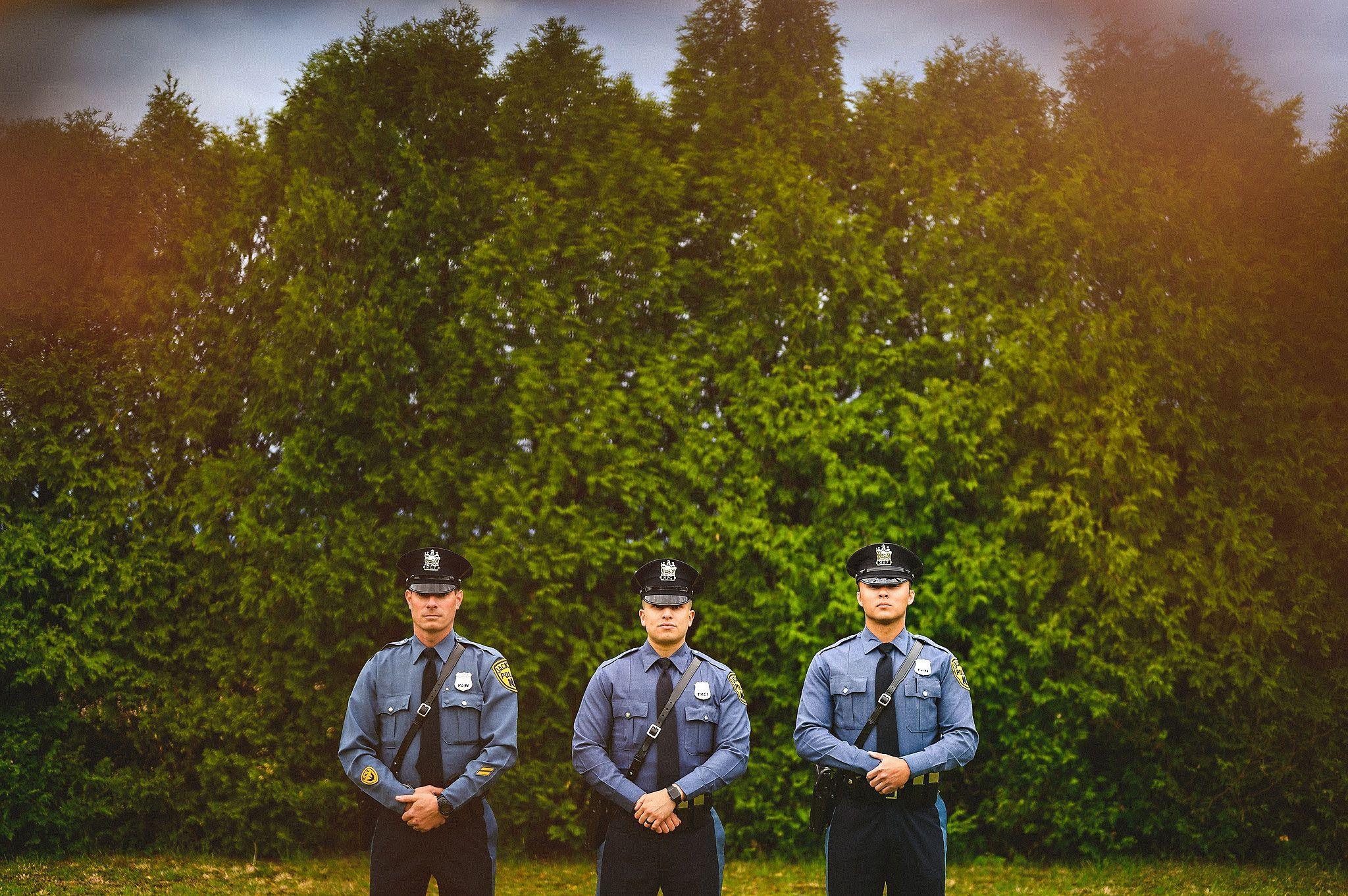 Police officers portrait in front of tree line