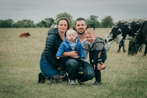 Zara Davis Photography Stroud Gloucestershire Cotswolds Family on floor cows