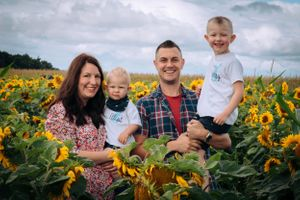 Zara Davis Photography Stroud Gloucestershire Cotswolds Family sunflowers family of four in sunflowers