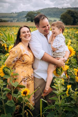 Zara Davis Photography Stroud Gloucestershire Cotswolds Family sunflowers giggles in flowers