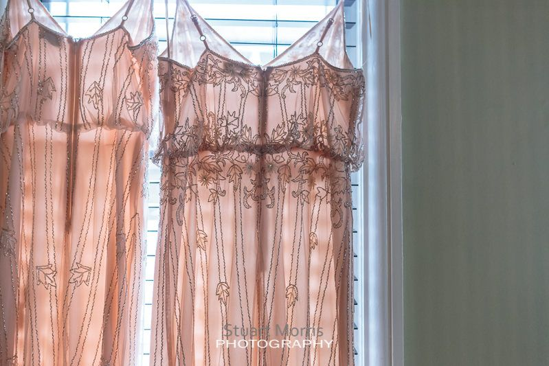bridesmaids dresses hanging from a window at the belle epoque knutsford