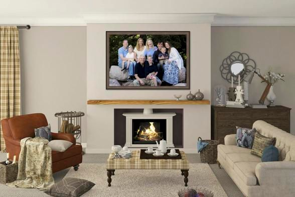 Living room with large framed family wall portrait on the wall above fireplace