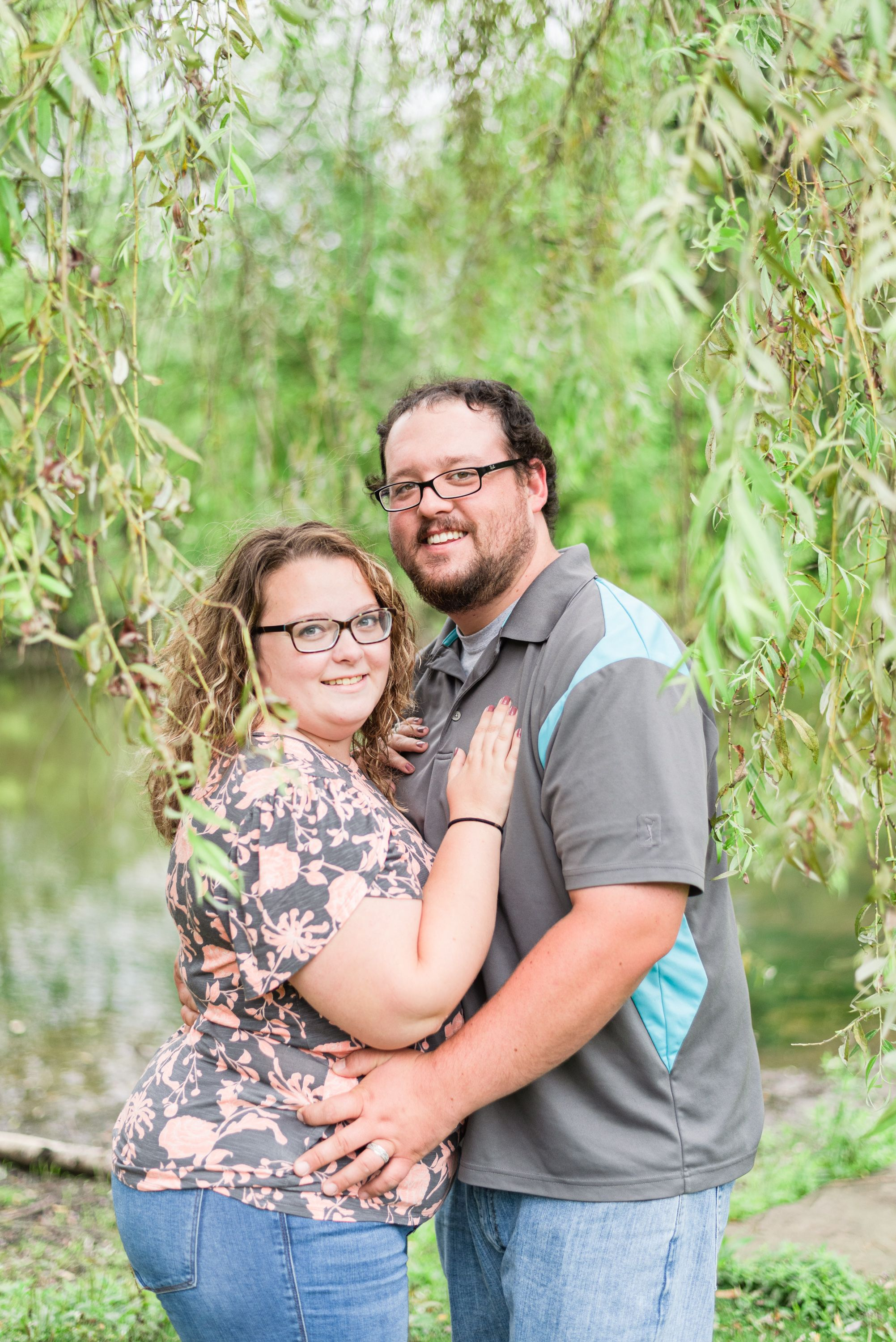 Couple standing under willow tree at Succop Conservancy in Butler Pennsylvania