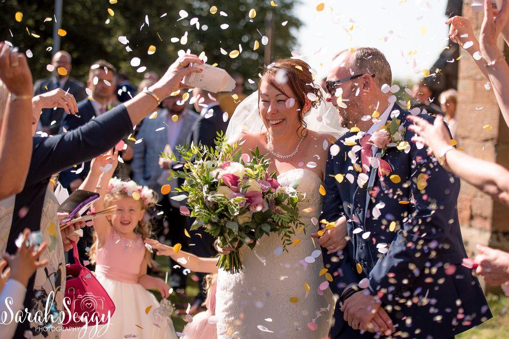 Confetti photo wedding photographer
