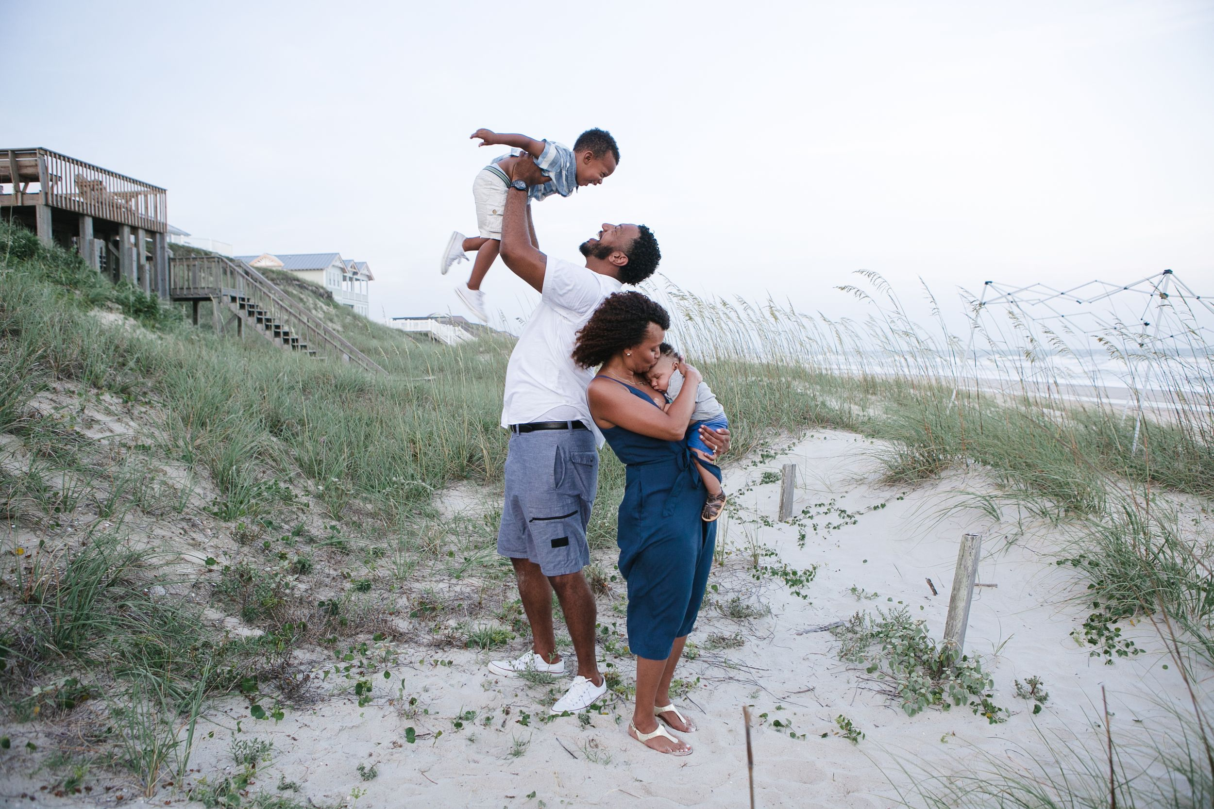 family playing at the beach in Emerald Isle, NC