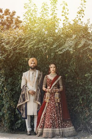 sikh wedding stunning couple in sabyasachi and pagh vala menswear
