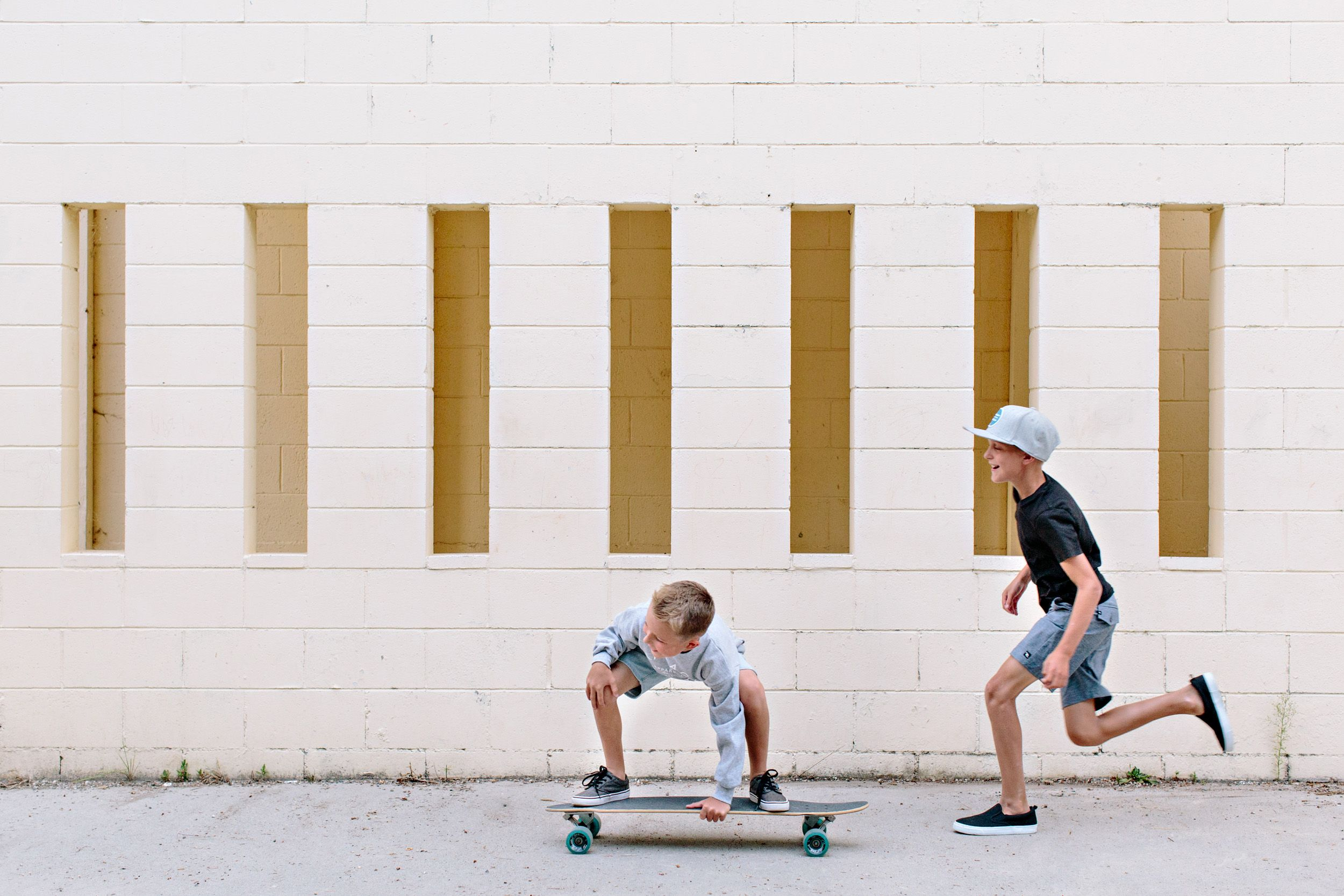 boys skateboarding and running