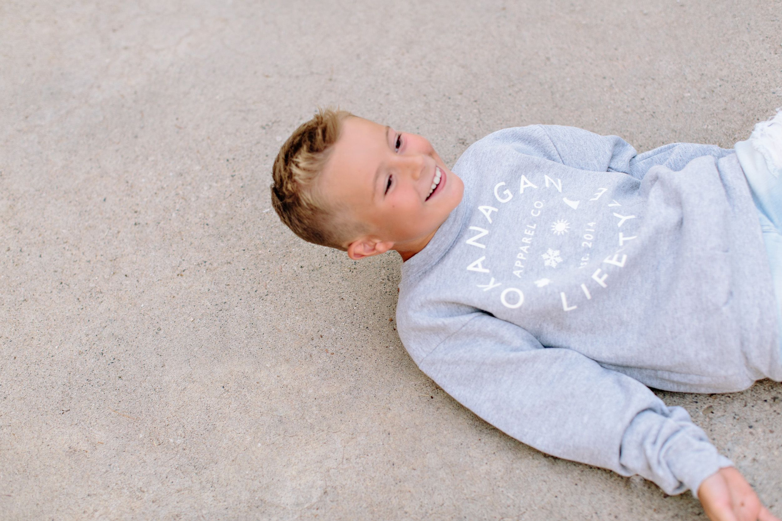 boy on ground laughing
