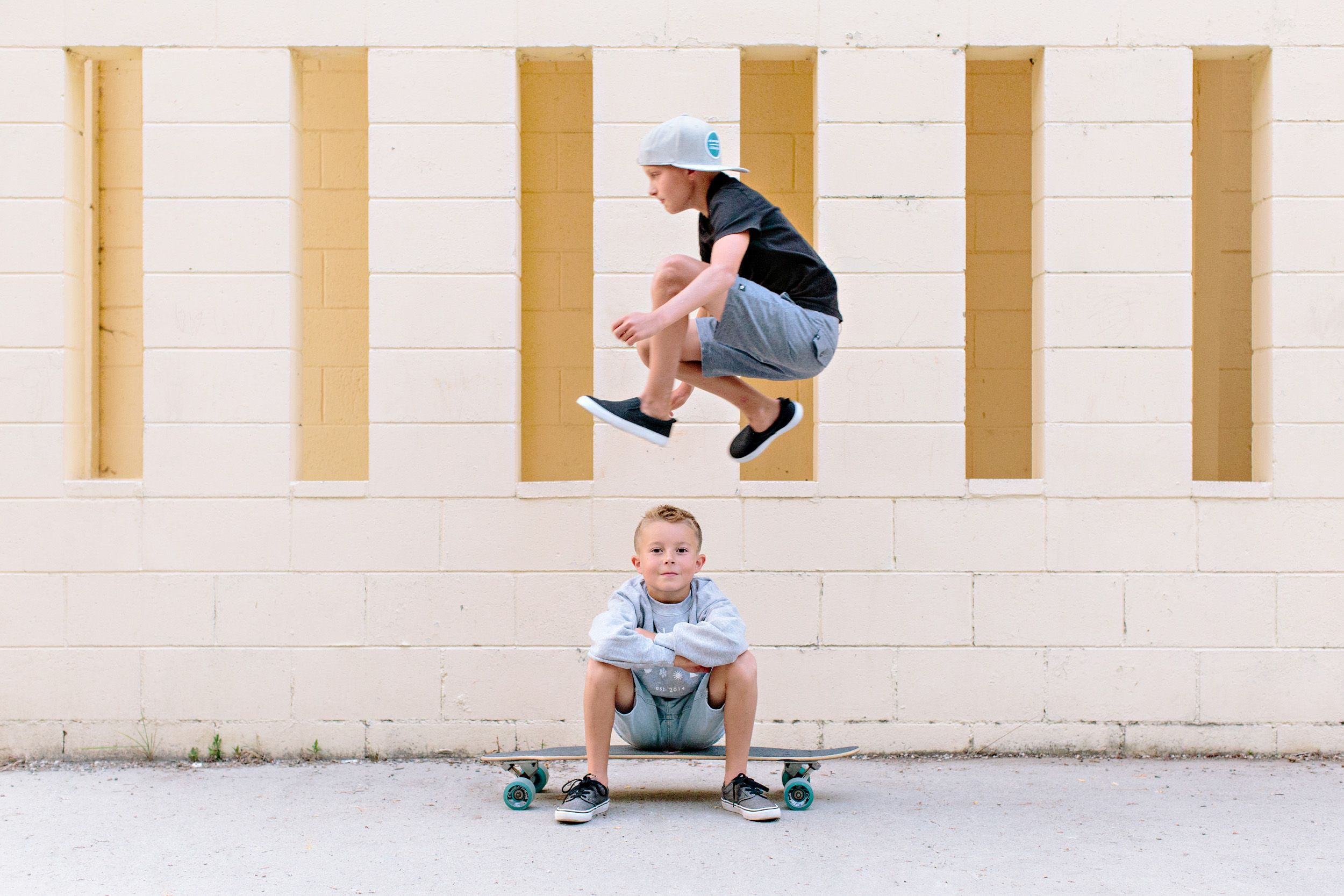 boy jumping over a boy on a skateboard