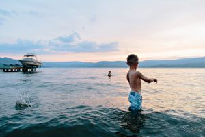 boys swimming in okanagan lake