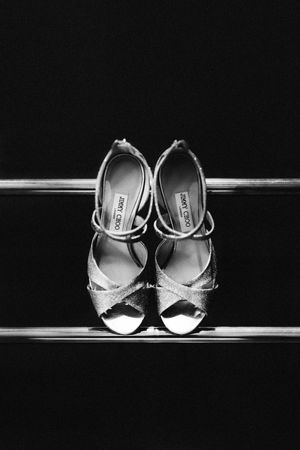 Black and white photograph of Jimmy Choo shoes taken at 131 in Cheltenham on the radiator
