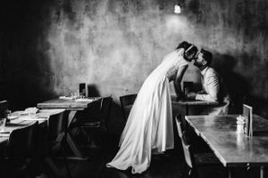 Black and white wedding photograph bride and groom kissing  at the Tavern cheltenham